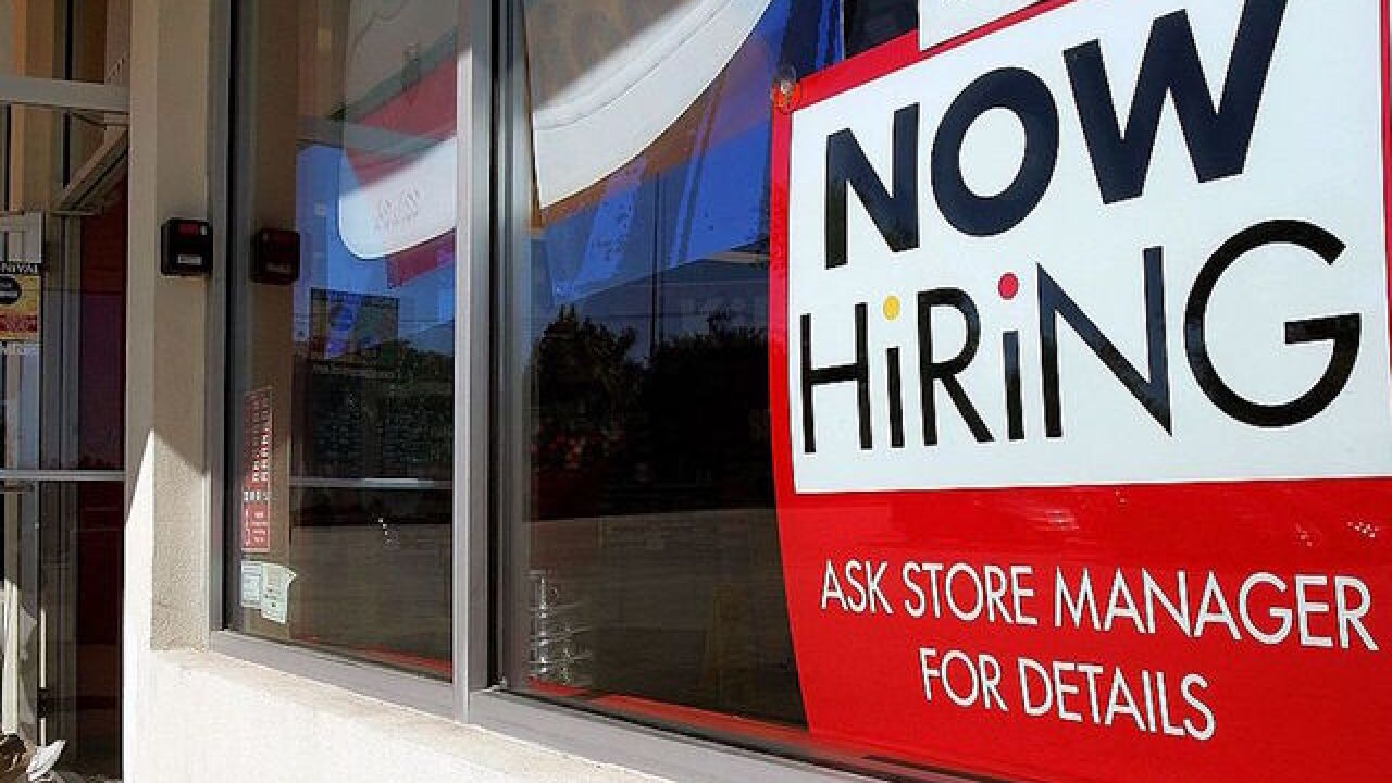 Americans are earning more per hour, and more are employed, jobs report says