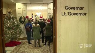 Carolers call for Florida fracking ban outside Gov. Ron DeSantis' office