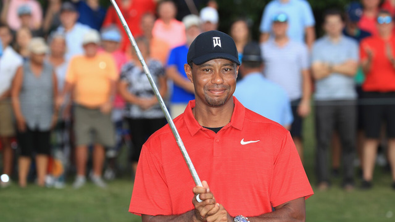 Tiger Woods wins a PGA Tour event for the first time since 2013