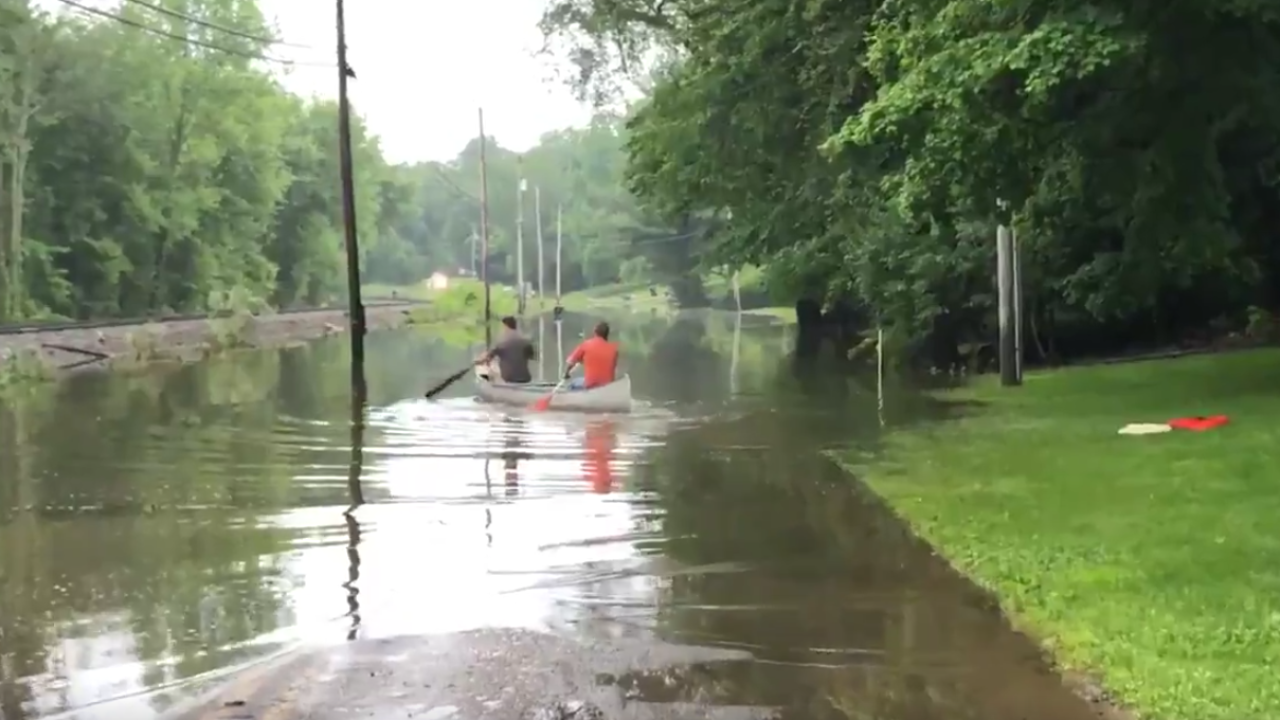 Grandsons canoe to grandpa's house during flood in Canal Fulton