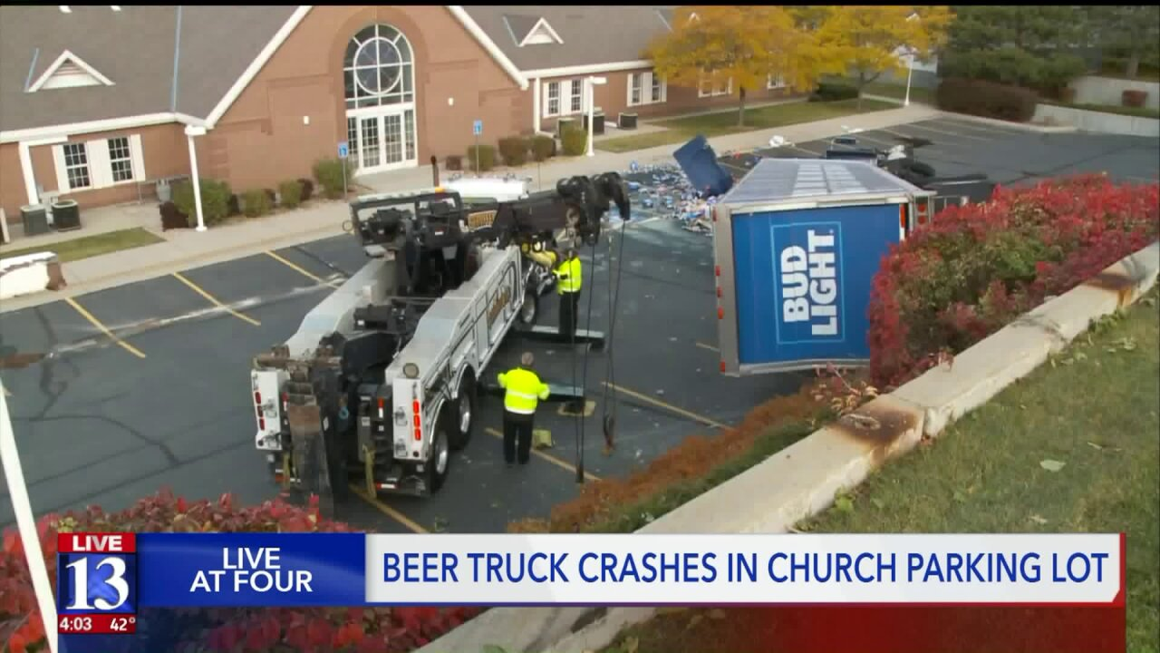 Semi hauling beer spills load across church parking lot in Sandy