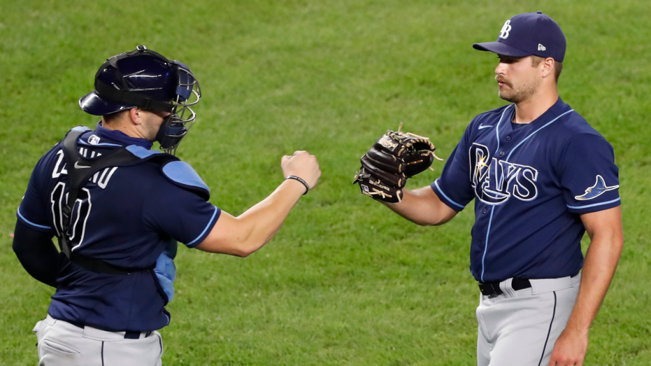 Mike-Zunino-celebrates-with-Jalen Beeks.png