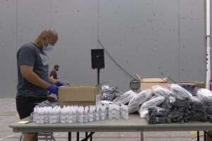 Volunteers assemble Health Fall Griz Kits for UM students, faculty