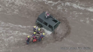 A man and his two young daughters were rescued from floodwaters near Catalina Wednesday morning.