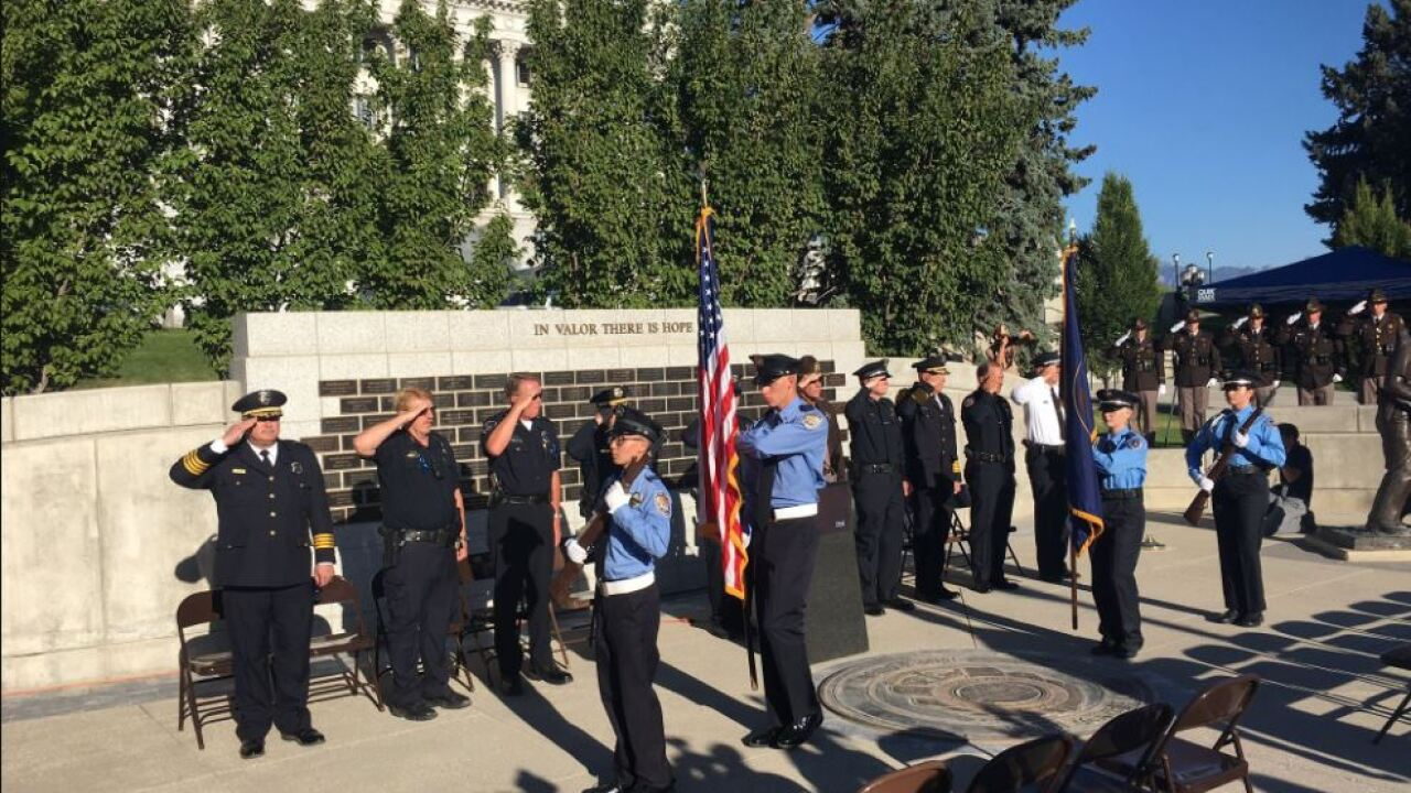 Hundreds attend vigil in SLC to honor Dallas officers killed in the line ofduty