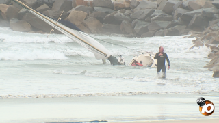oceanside sailboat crashes into jetty