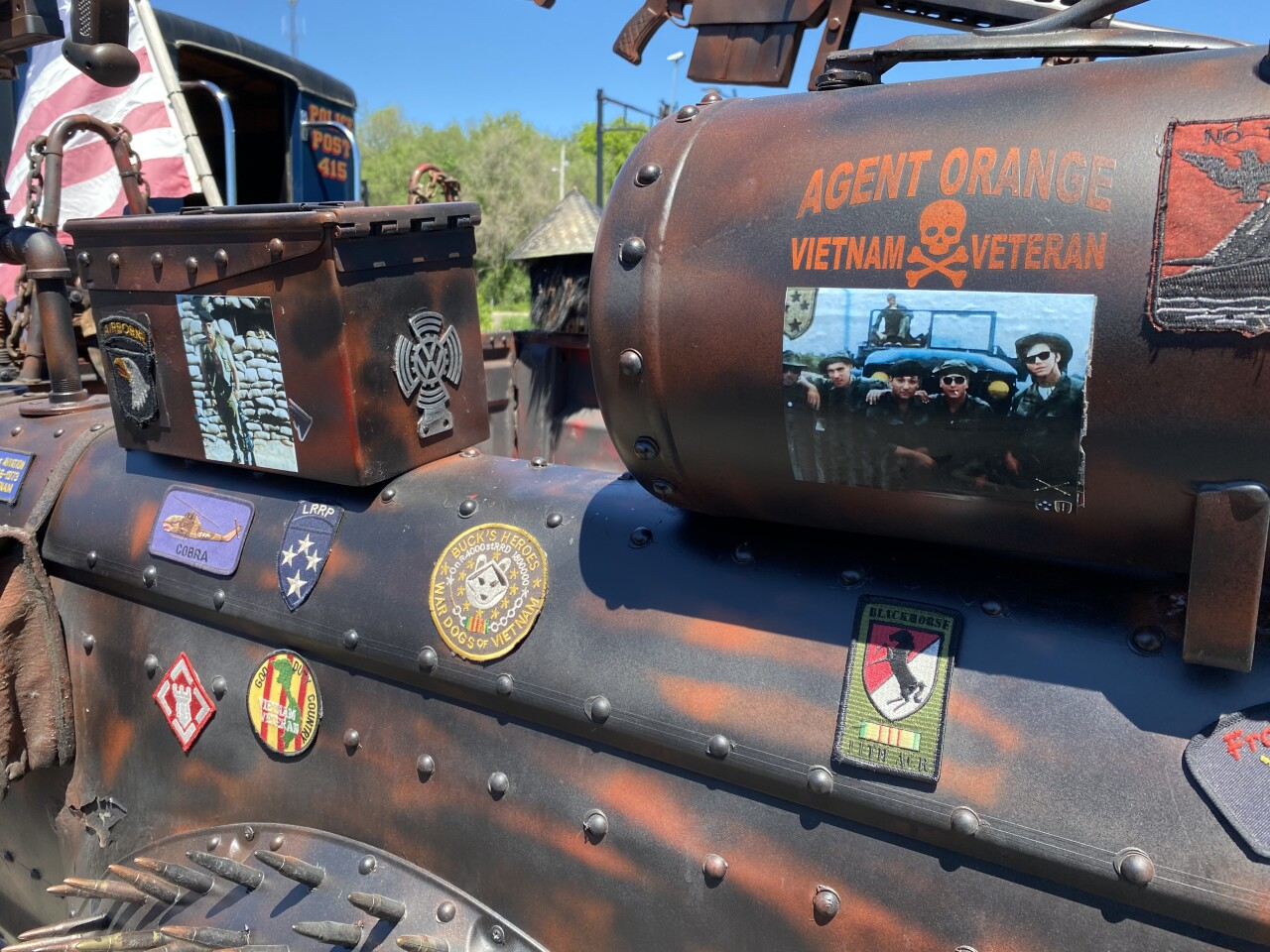 Vietnam Veteran Hector Zayas is pictured alongside of the men he served with. He decorated this truck as a way to remember them and others who lost their lives.