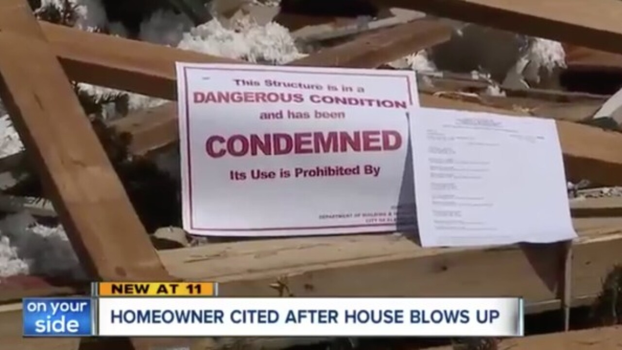 City cites owner of house as it's being looted
