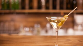 A glass of martini on the bar counter of a elegant restaurant