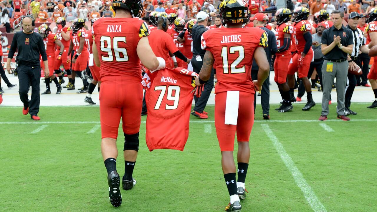 McNair jersey carried by teammates.JPG