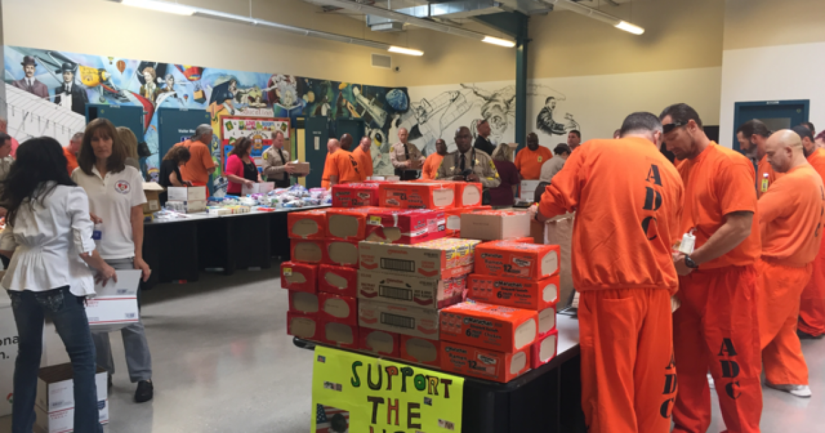 Inmates stuff care packages for troops