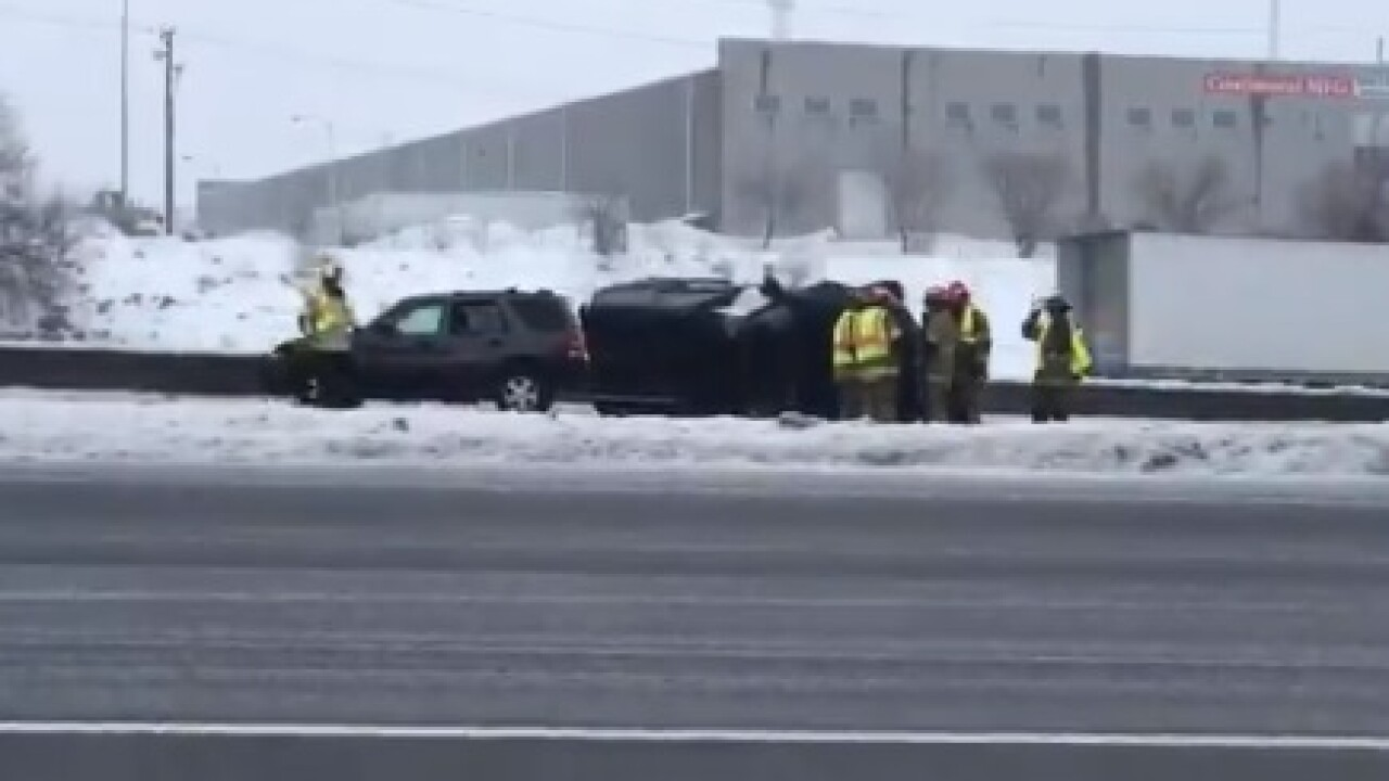 I-80 rollover crash in winter storm at i street exit