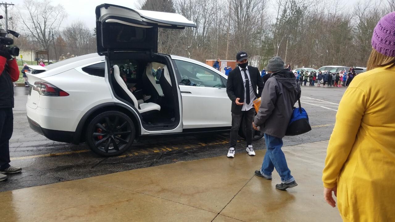 thumbnail_7) Mr. White approaches the Tesla.jpg