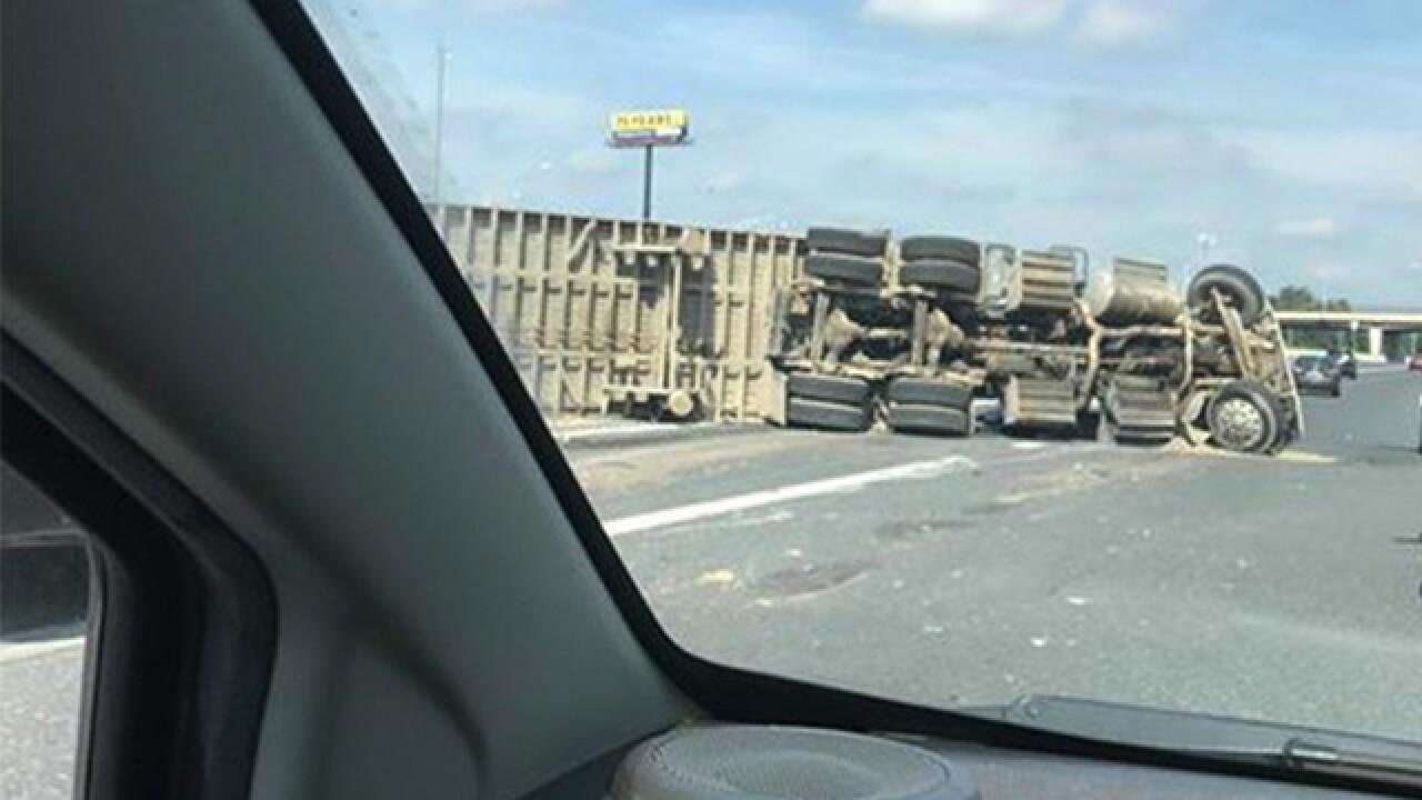 Overturned truck spills debris, closes I-895