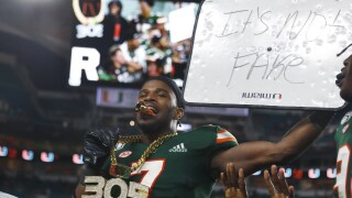 Miami Hurricanes cornerback Al Blades holds 'It's Not Fake' sign in 2019