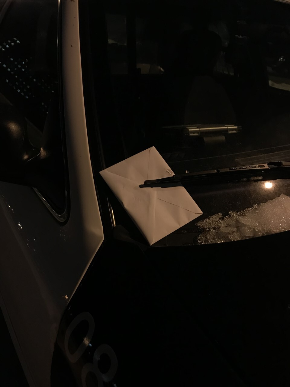 After the procession, someone left cards on each squad car outside the Police Administration Building Wednesday evening.