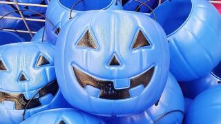 Blue Halloween buckets let others know children have autism, are nonverbal
