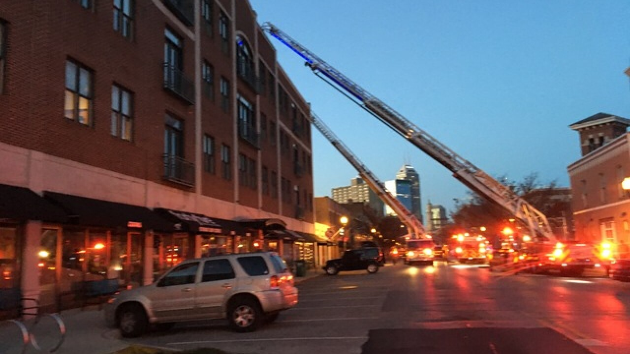 Apartment roof catches fire in Indianapolis