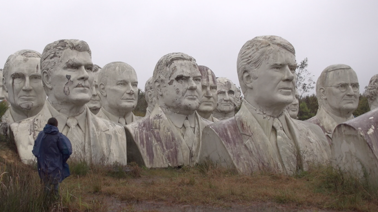 Decaying statues of presidential heads become unintentional tourist attraction