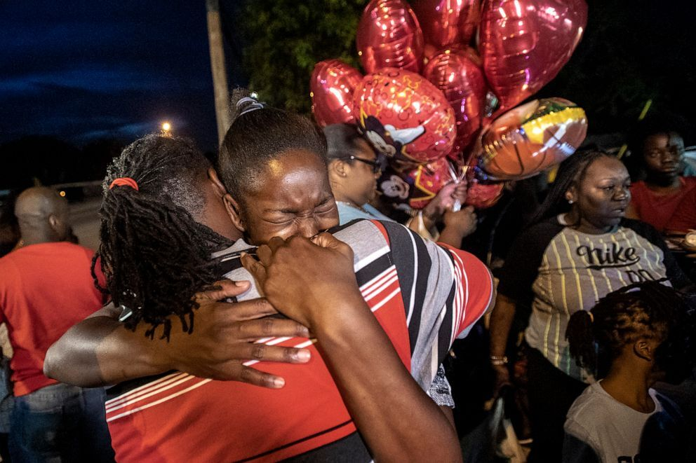 Chanese Sneed, the mother of Noah Sneed hugs Noah's father Tony Bell during a gathering to honor his life with a candlelight memorial in front of the Ceressa's Daycare & Preschool Center, July 30, 2019, in Oakland Park, Fla. Michael Laughlin/Sun Sentinel/TNS via Getty Images