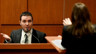 yust on witness stand murder trial