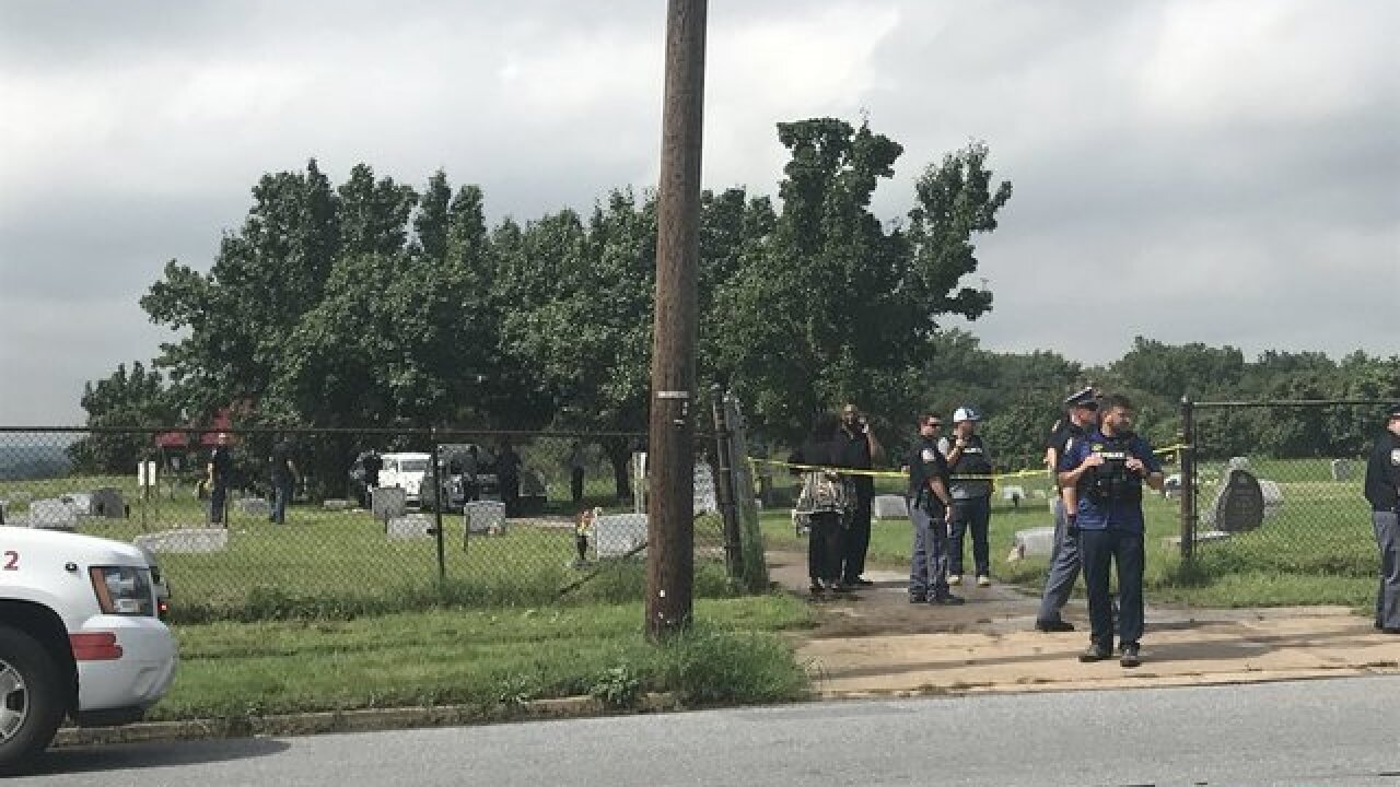 Shots fired at cemetery, school on lockdown