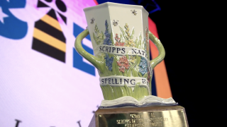 The championship trophy is on stage in Florida, ready to be handed to a new champion of the Scripps National Spelling Bee.