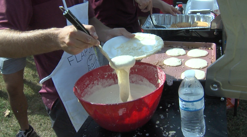 Aggie cooking bright and early for his fellow tailgaters.PNG