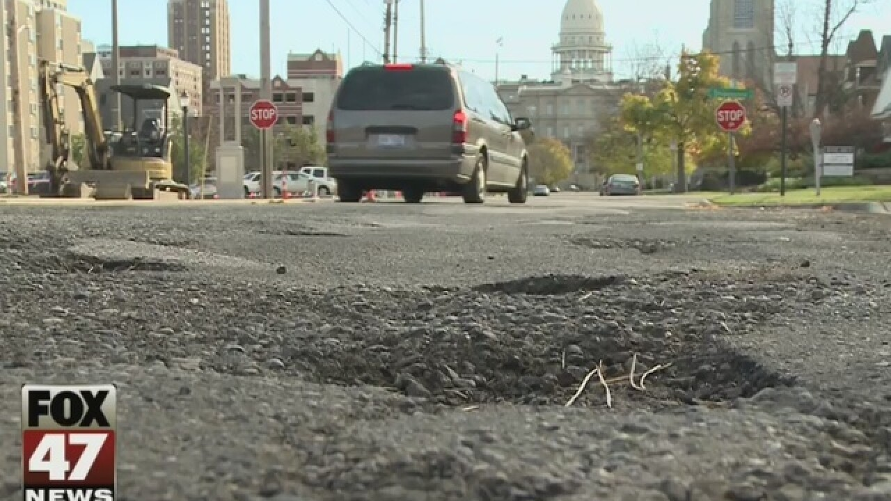 Road crews getting potholes filled