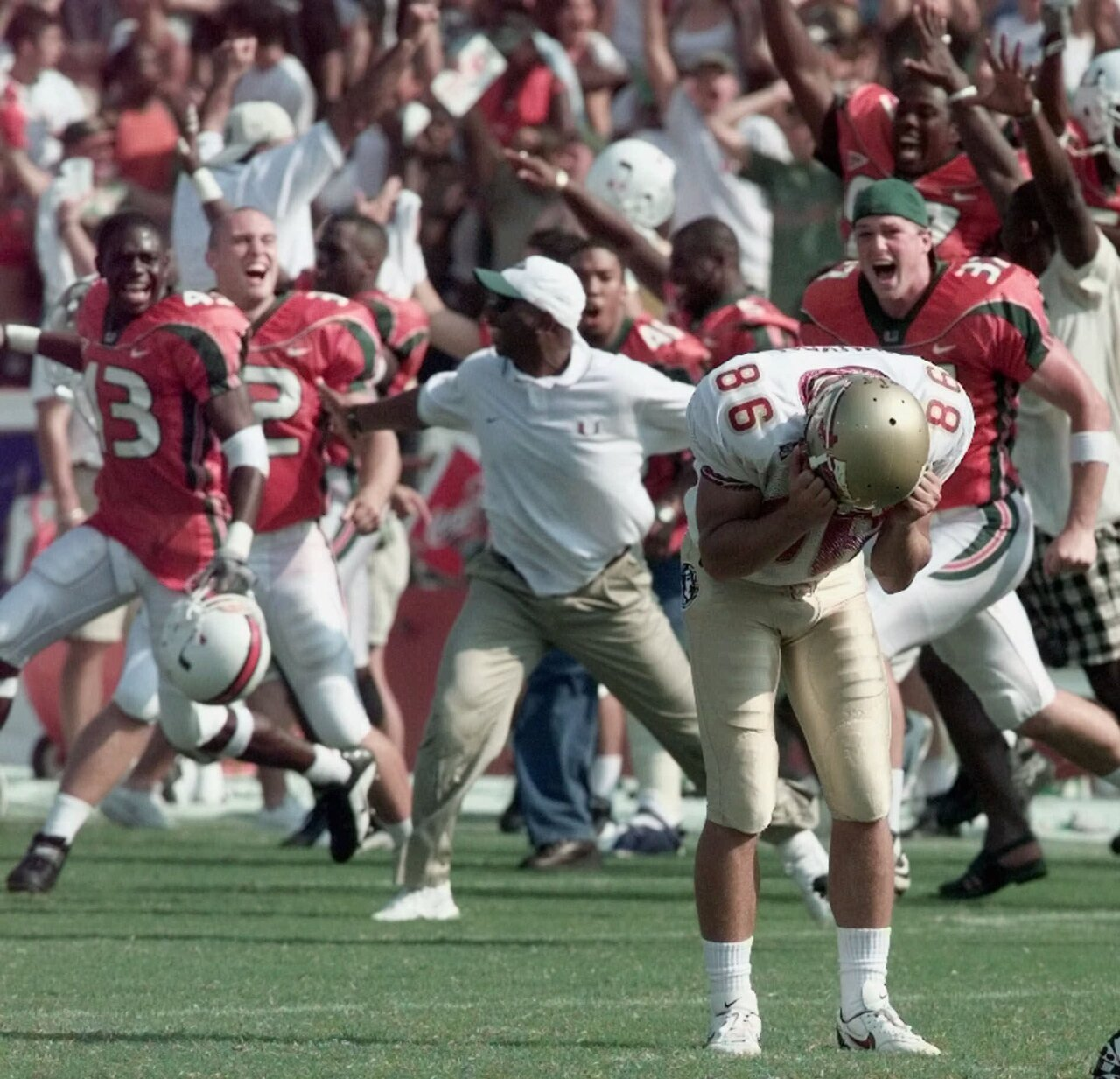 Florida State Seminoles kicker Matt Munyon clutches helmet after 'Wide Right III' against Miami Hurricanes in 2000
