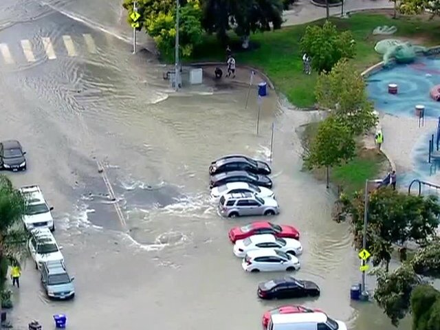 PHOTOS: Water main break in North Park leads to flooding