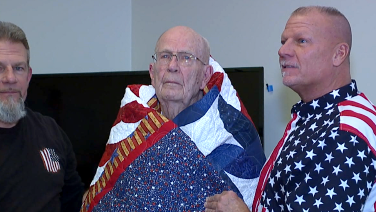 WCPO herman lorance with quilt.png