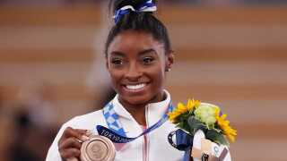 Biles trained in secret at Tokyo university to conquer 'twisties,' win bronze