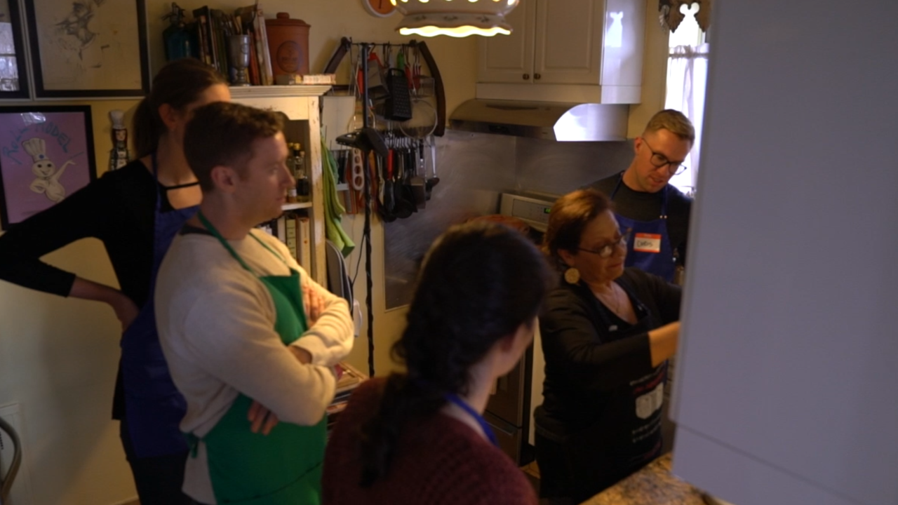 Unique program invites strangers into immigrants' homes to learn culture through food