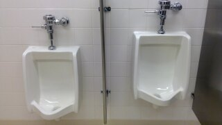 Two urinals in a public bathroom.