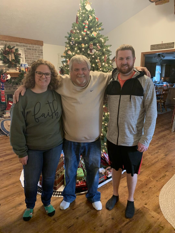 Matt, his sister and dad around Christmas.  CREDIT: Alexander Family