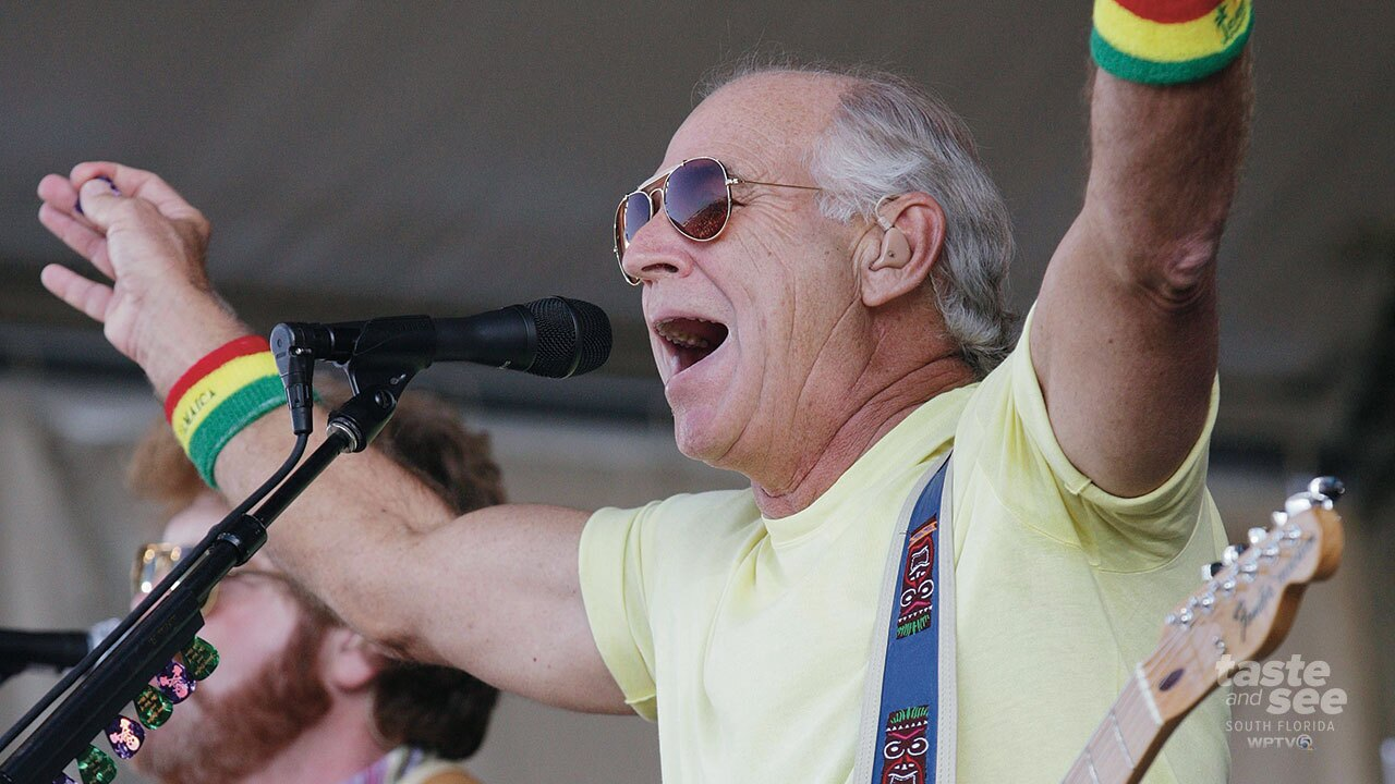 In this May 3, 2008 file photo, Jimmy Buffett performs during the 2008 New Orleans Jazz & Heritage Festival in New Orleans. Music lovers are converging this week on the Crescent City for the festival, which takes place over two weekends starting on Friday, April 27, 2018, featuring out-of-town artists such as Rod Stewart and Sting, as well as performers from across New Orleans and Louisiana.