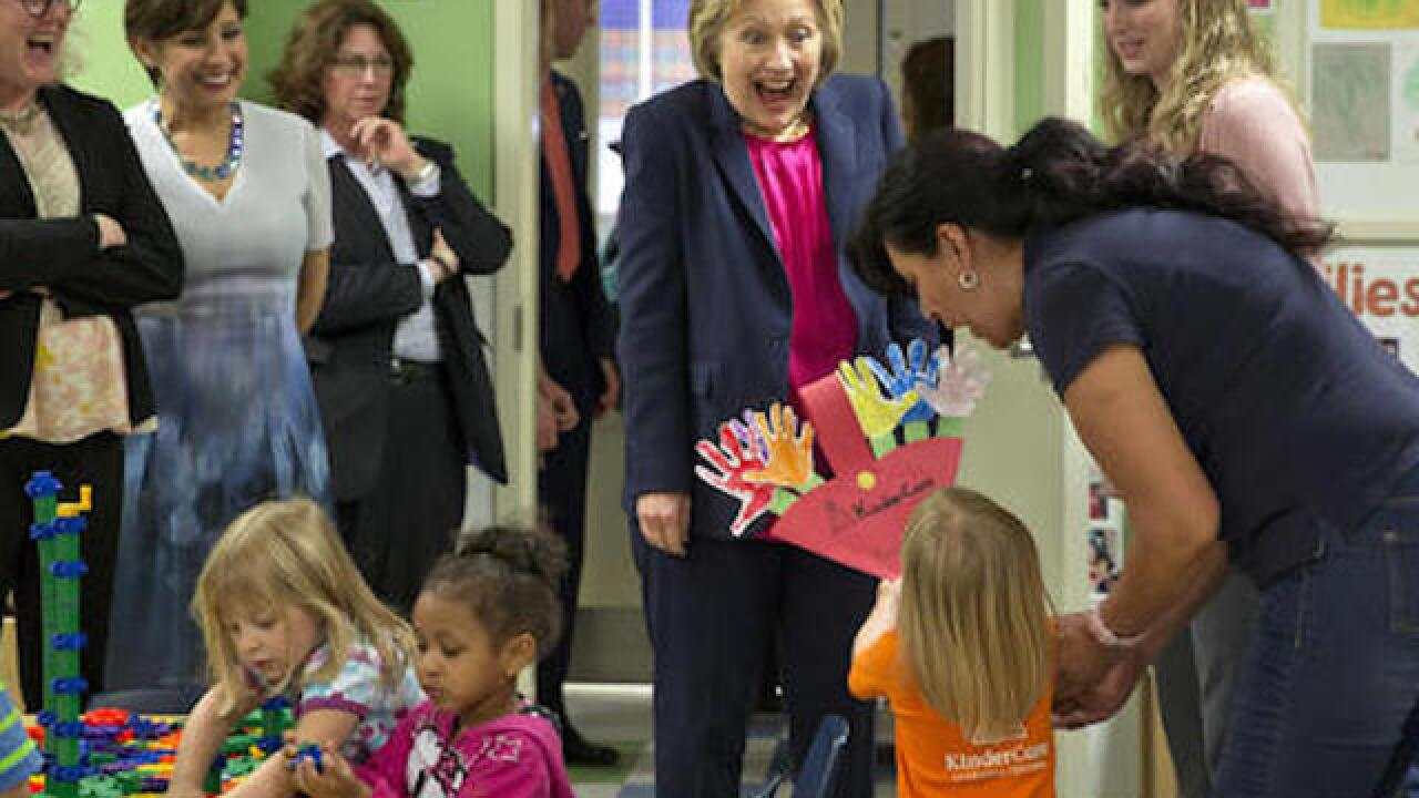 Clinton proposes cap on family child-care costs