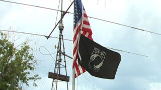 POW/MIA flag over post offices