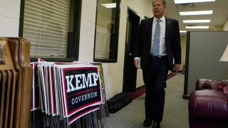 In Georgia, Kemp sets out to mend fractured GOP