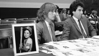John Walsh, Reve Walsh sit next to picture of son Adam Walsh, Nov. 18, 1981