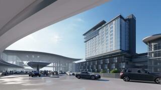 Crews break ground on new BNA hotel, parking garage