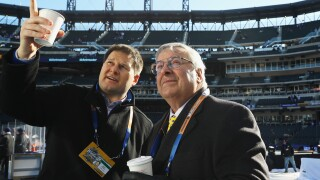 Terry Pegula and Jason Botterill chat before NHL Winter Classic
