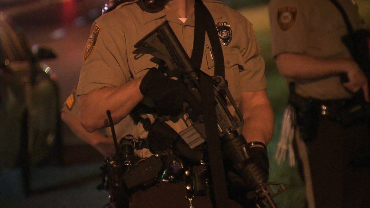 Officer suspended after pointing assault rifle at Ferguson protester