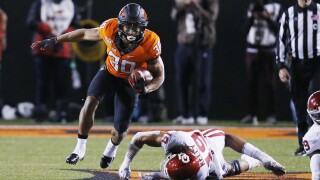 Oklahoma State's star running back threatens not to play over coach's OAN support