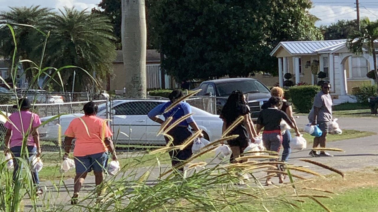 Pastor Kenny Berry and volunteers deliver food to children and seniors