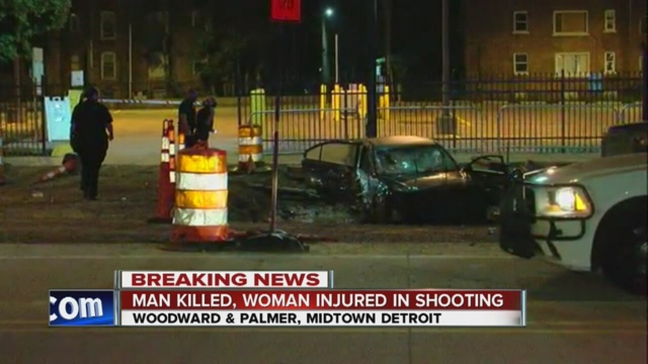 Man shot, killed driving on Woodward in Midtown