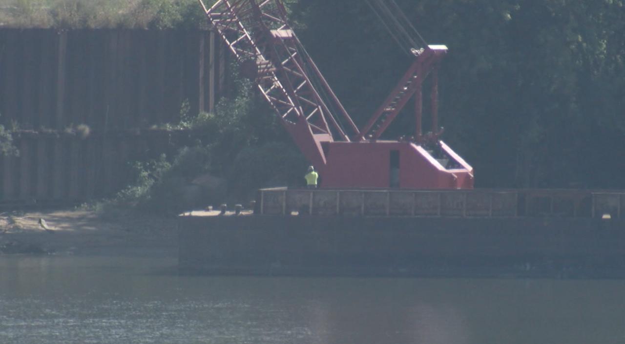 Crews work on barge-mounted crane at Beckjord on Sept. 17, 2021.