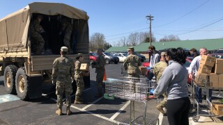 The National Guard helps distribute donations through the Food For All pantry drive-through