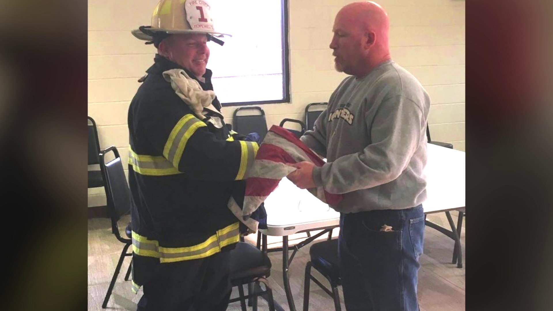 Photos: Firefighters save American flag outside burning building: 'It just felt like the rightthing'